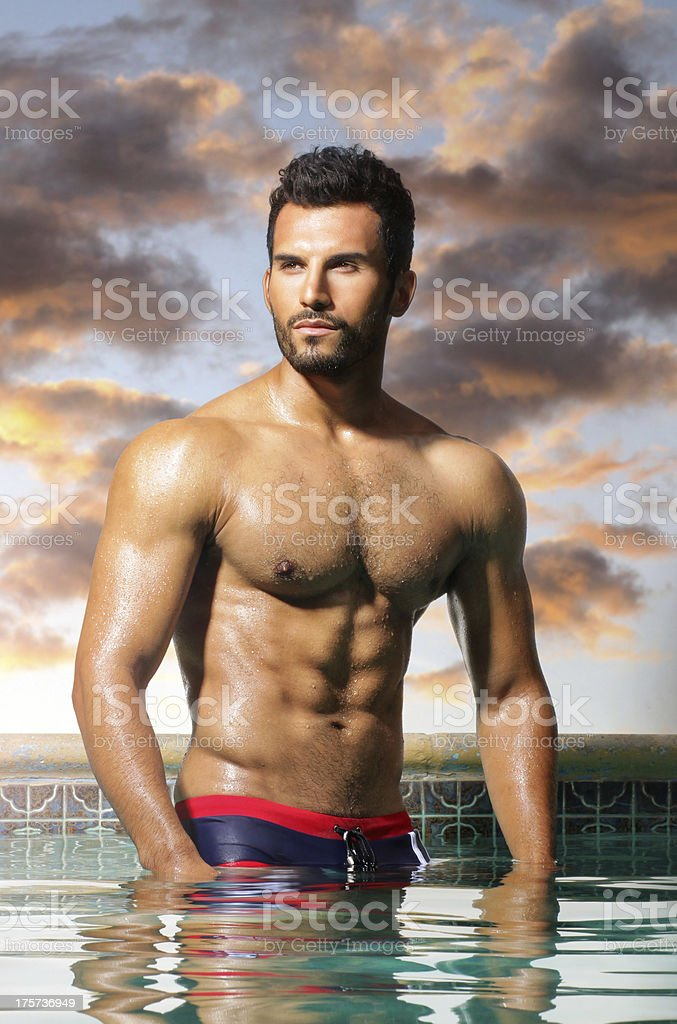 Muscled Man With Perfect Abs In Pool Stock Photo