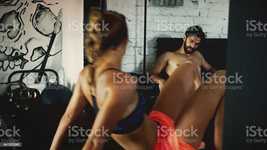 Muscled people talking about working out stock photo