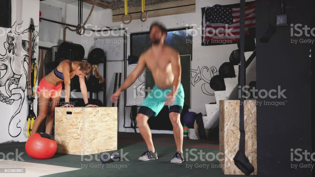 Muscled people working out stock photo