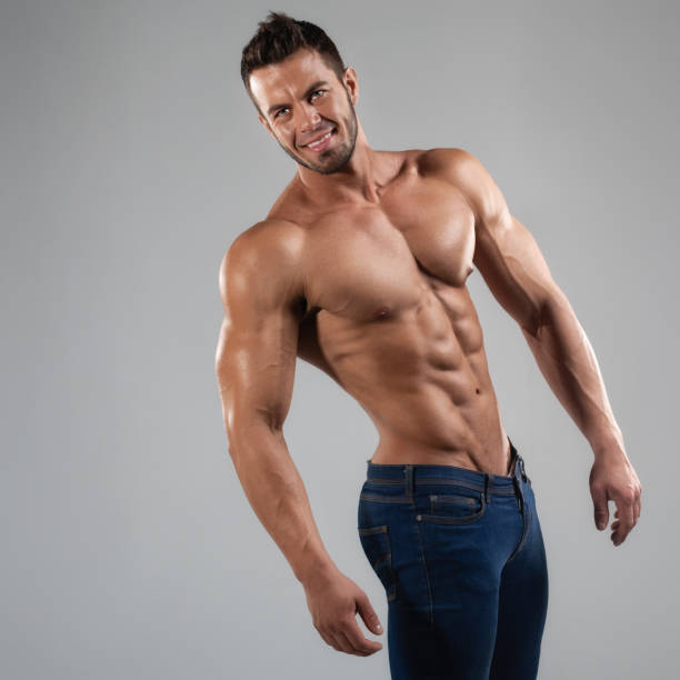 Muscled sexy man in the studio stock photo