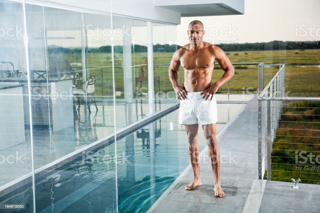 Muscular African American man by pool royalty-free stock photo
