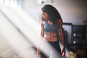 istock muscular african american woman sweating from work out in home gym 930998708