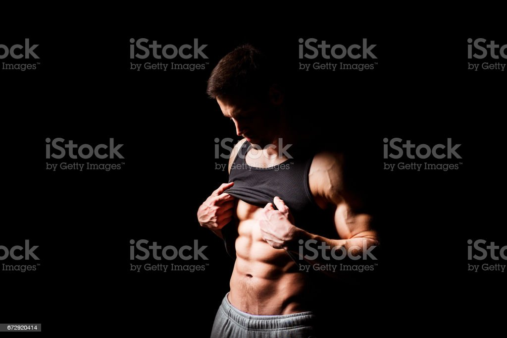 Muscular and sexy torso of young man having perfect abs. Male hunk with athletic body. Fitness concept stock photo