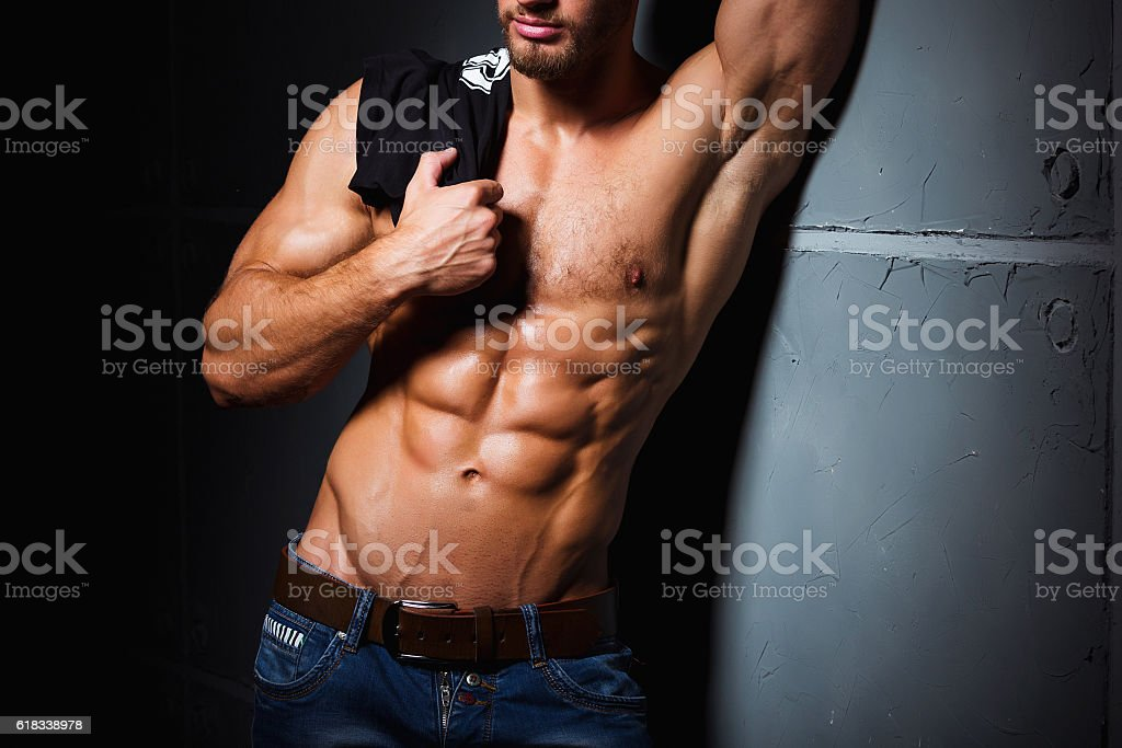 Muscular and sexy torso of young man having perfect abs stock photo