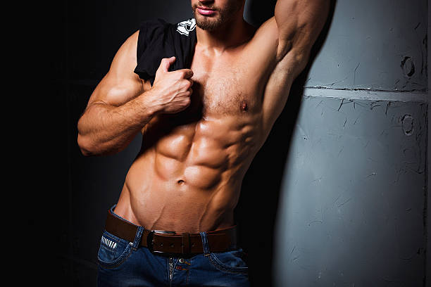 Muscular and sexy torso of young man having perfect abs Muscular and sexy torso of young man with perfect abs. Athletic body of young hunk. Fitness concept. chest torso stock pictures, royalty-free photos & images