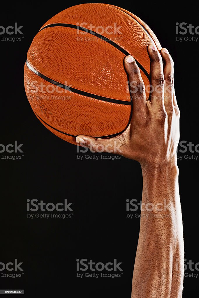 Muscular arm of a basketball player ready to shoot stock photo