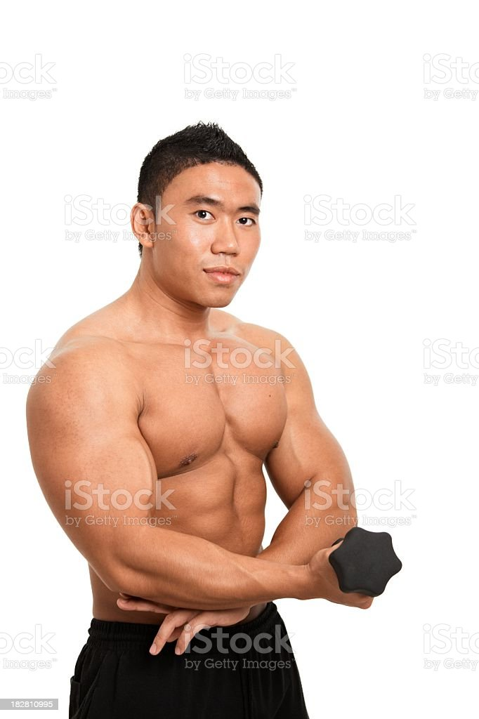 Muscular asian man exercising royalty-free stock photo