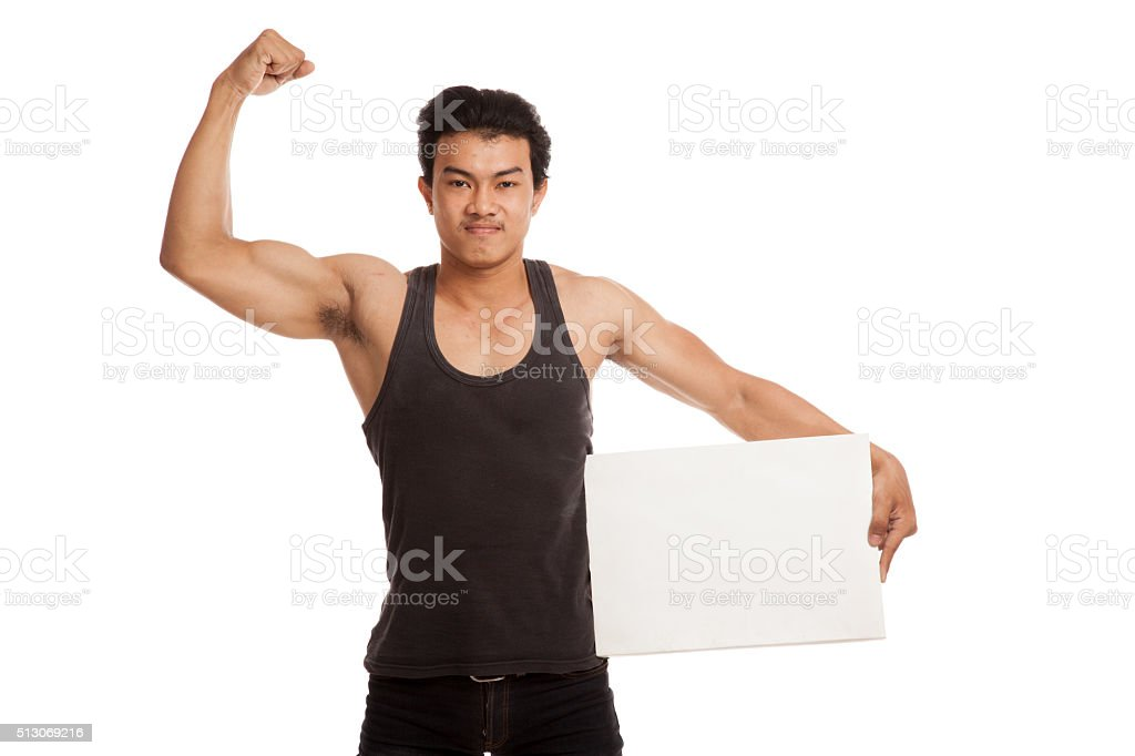 Muscular Asian man flexing biceps with blank sign stock photo
