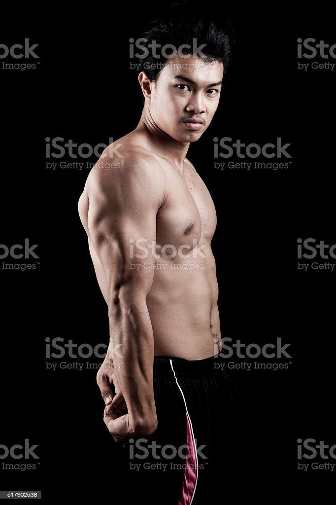 Muscular Asian man  show his body stock photo