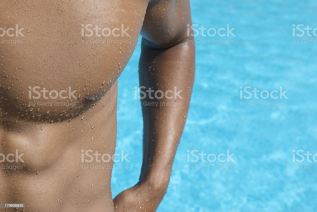 Muscular Athlete Swimmer Stands at Blue Swimming Pool royalty-free stock photo