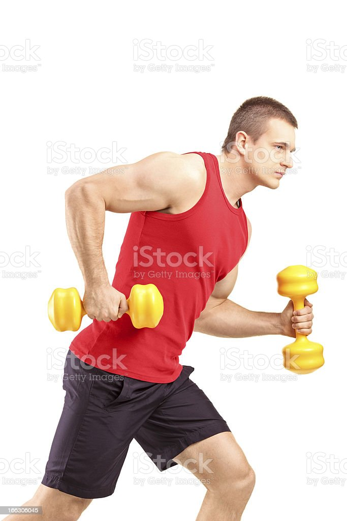 Muscular athletic man lifting weights royalty-free stock photo