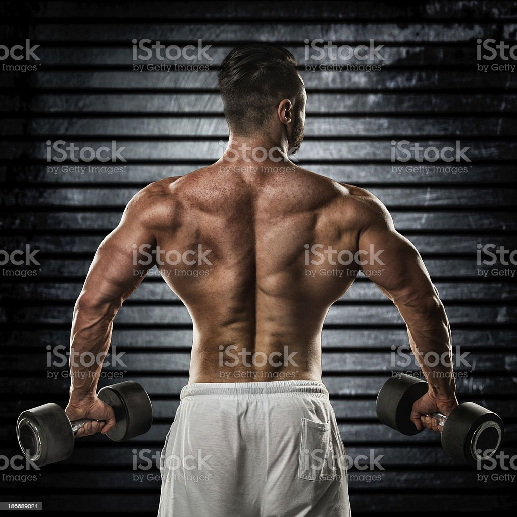 Muscular back of male bodybuilder royalty-free stock photo