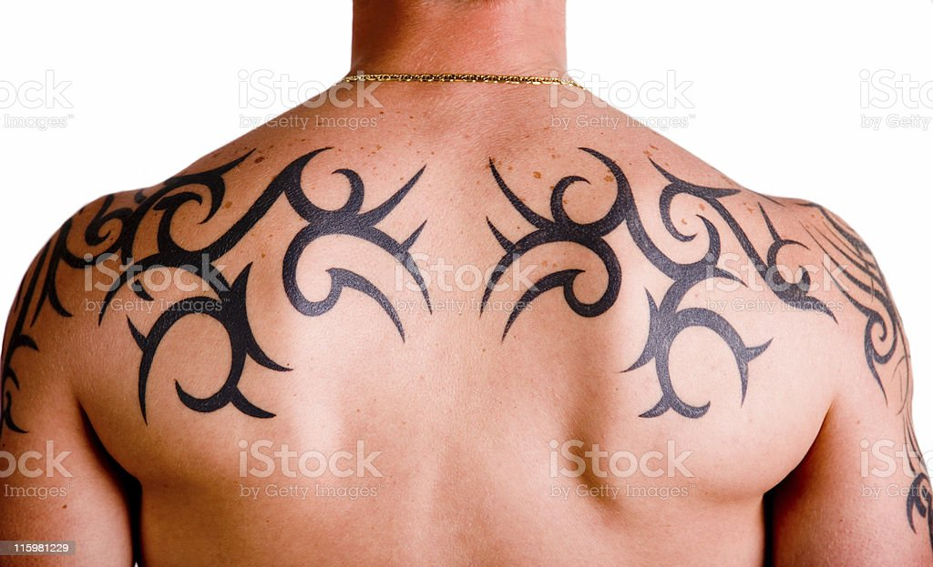 Muscular back with tribal tattoo stock photo