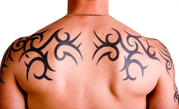 Muscular back with tribal tattoo​​​ foto