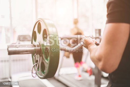 istock Muscular Bearded man during workout in the gym. 1098317240