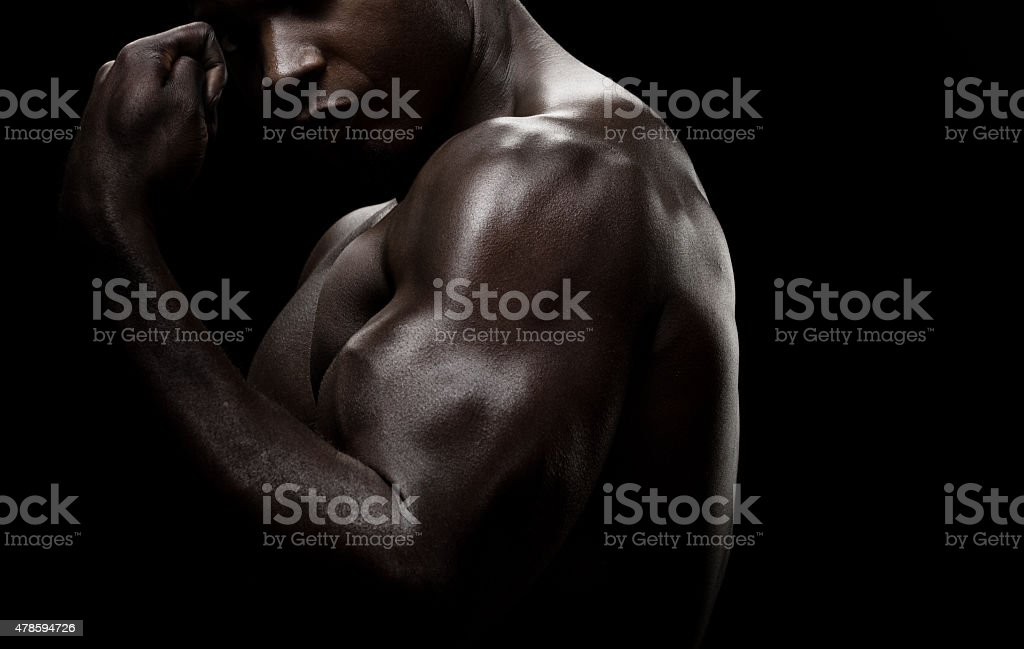 Muscular black male posing stock photo