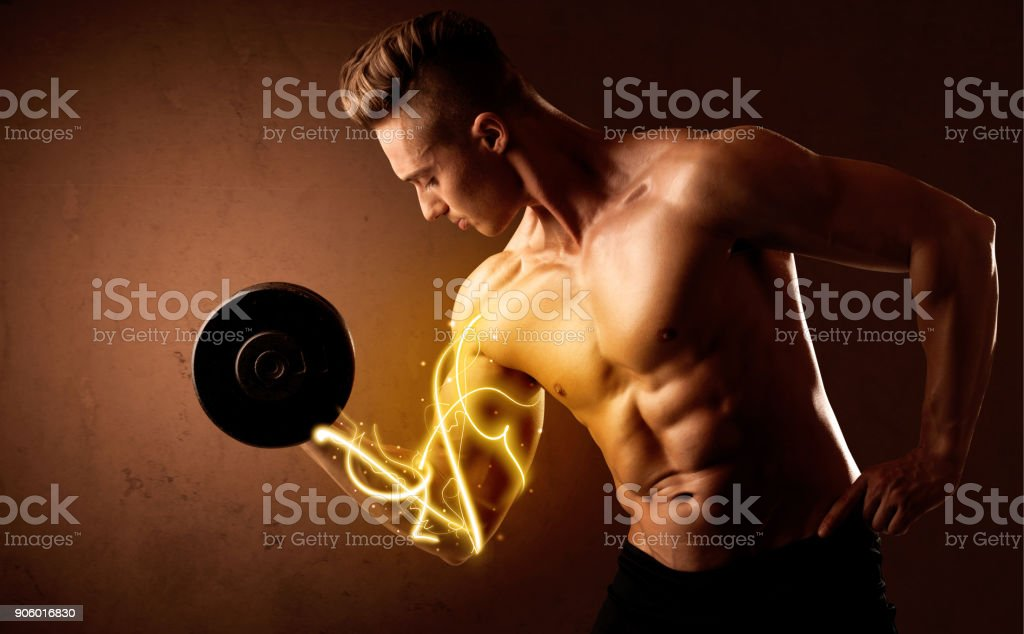Muscular body builder lifting weight with energy lights on biceps stock photo