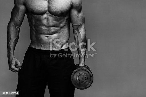 istock muscular bodybuilder guy close up monochrome 468365254