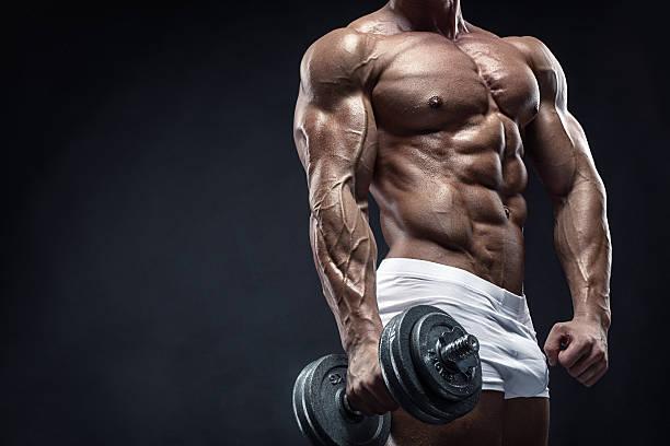 Cтоковое фото Мышечная парень делать упражнения с bodybuilder гантель