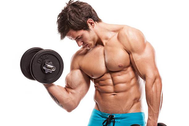 Cтоковое фото bodybuilder Мышечная парень делать Упражнения с гантелями над whi
