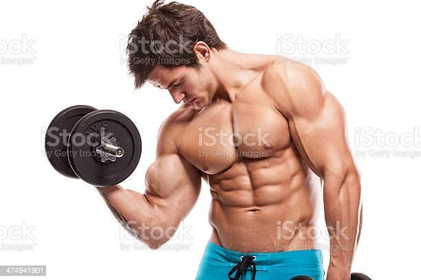 Muscular Bodybuilder Guy Haciendo Ejercicios Con Pesas En Whi Foto de stock y más banco de imágenes de Abdomen