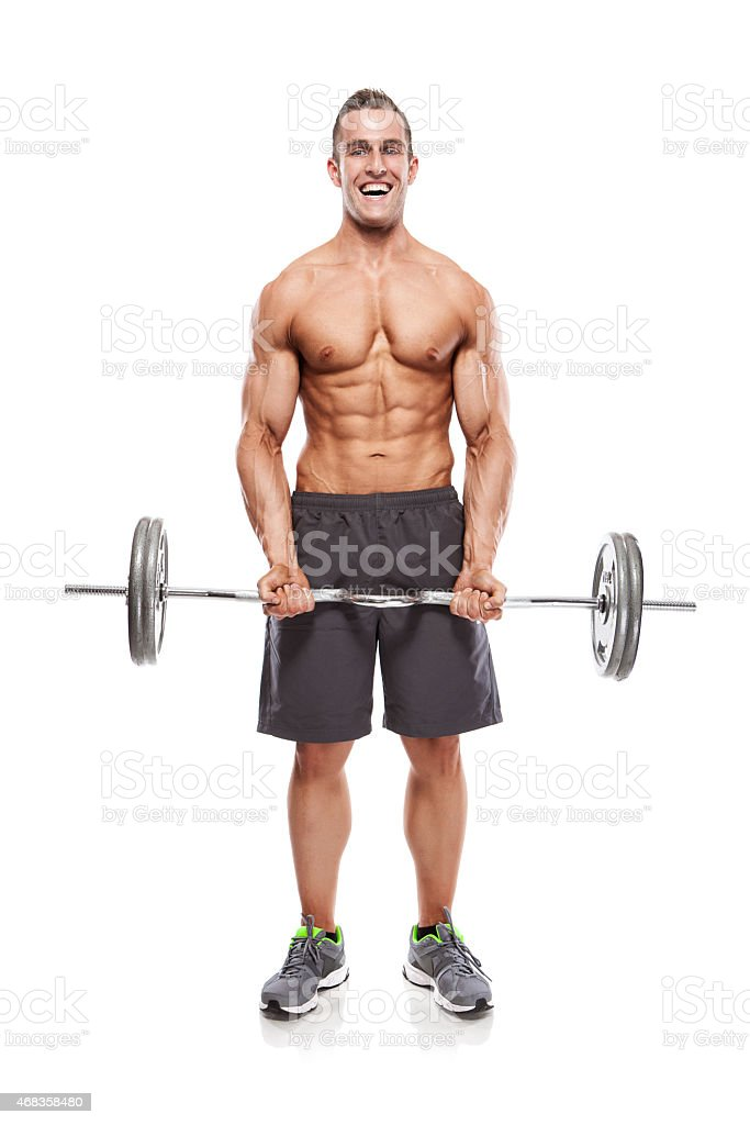 Muscular bodybuilder guy doing exercises with dumbbells royalty-free stock photo