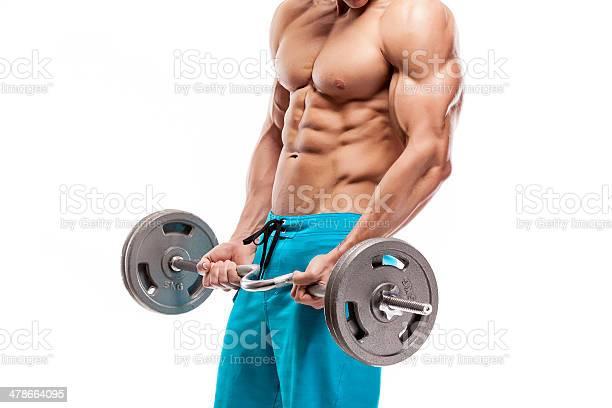 Muscular Bodybuilder Guy Haciendo Ejercicios Con Pesas Foto de stock y más banco de imágenes de Recortable