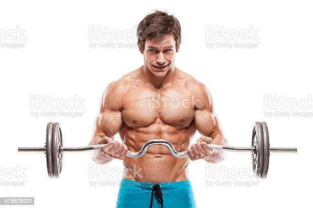 Muscular Bodybuilder Guy Haciendo Ejercicios Con Pesas Foto de stock y más banco de imágenes de Abdomen