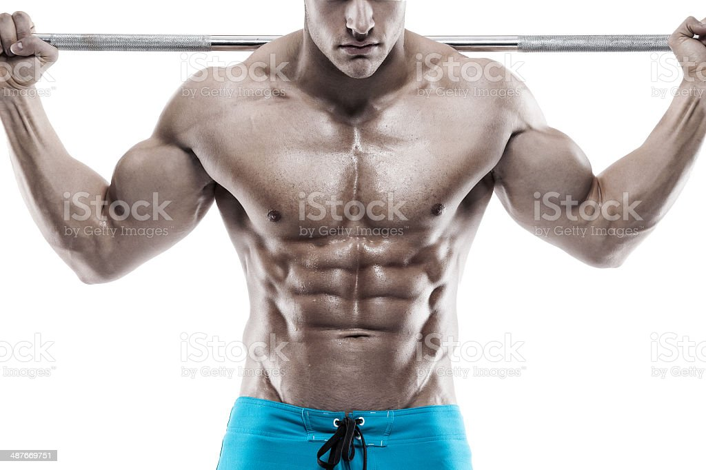 Muscular bodybuilder guy doing exercises with dumbbells stock photo