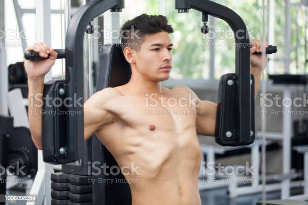 Muscular bodybuilder guy doing heavy weight exercise for chest in the picture id1006098254?b=1&k=6&m=1006098254&s=612x612&h=igg d6enfiolinhn734whijdv040wkqfdxlvlrndbju=