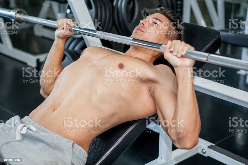 Peachy Muscular Bodybuilder Guy Doing Lifting Weight While Working Ibusinesslaw Wood Chair Design Ideas Ibusinesslaworg