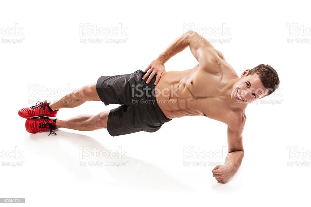 Muscular bodybuilder guy doing pushups stock photo