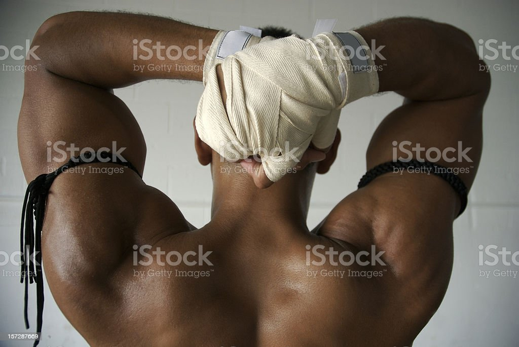 Muscular Boxer Stretches with Hand Wraps royalty-free stock photo