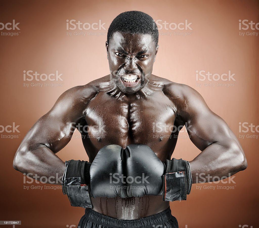 Muscular boxer with intense emotion royalty-free stock photo