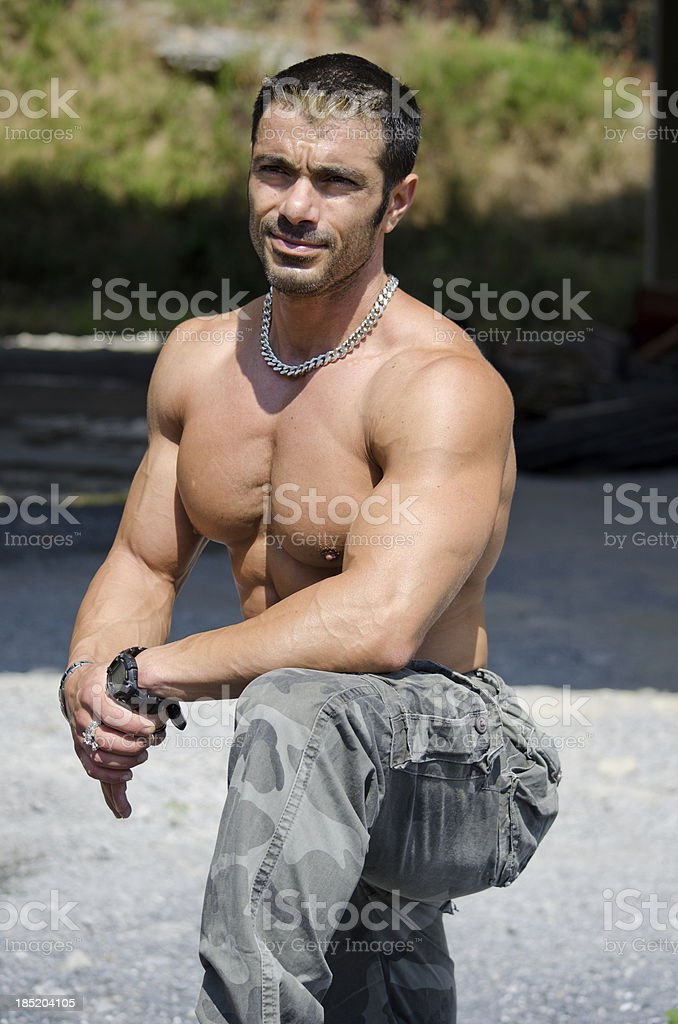 Muscular construction worker shirtless in building site royalty-free stock photo