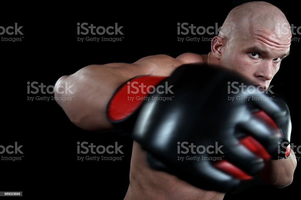 Muscular fighter in action royalty-free stock photo