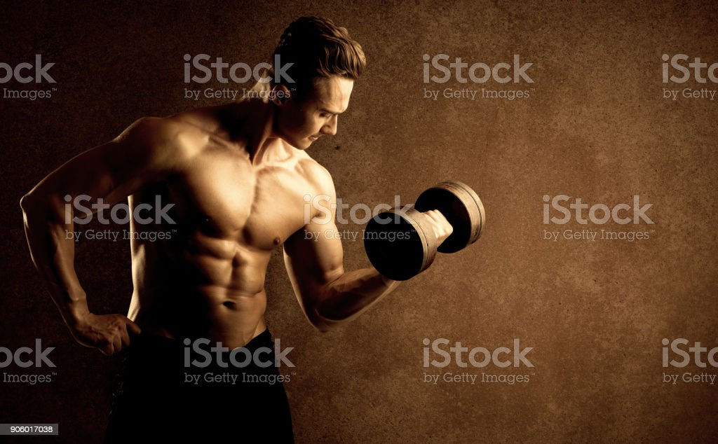 Muscular fit bodybuilder athlete lifting weight stock photo