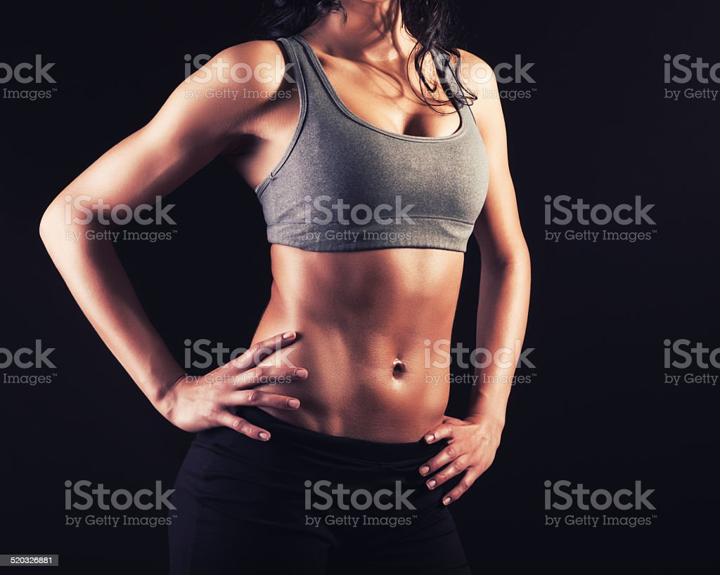 Muscular fit young girl stock photo