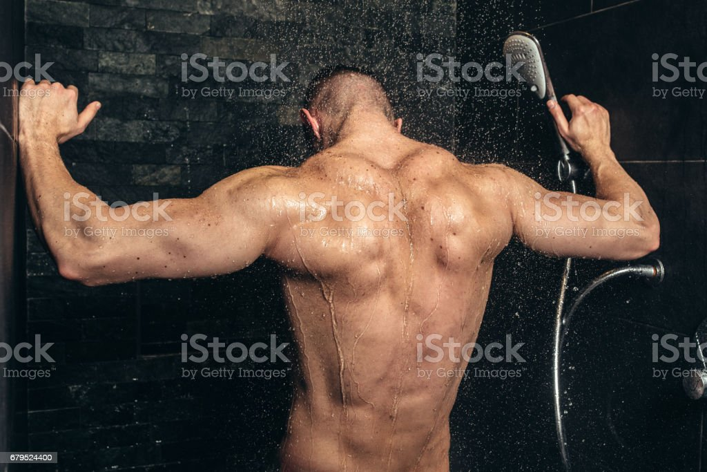 Muscular Fitness Bodybuilder Taking A Shower After Training Close Up