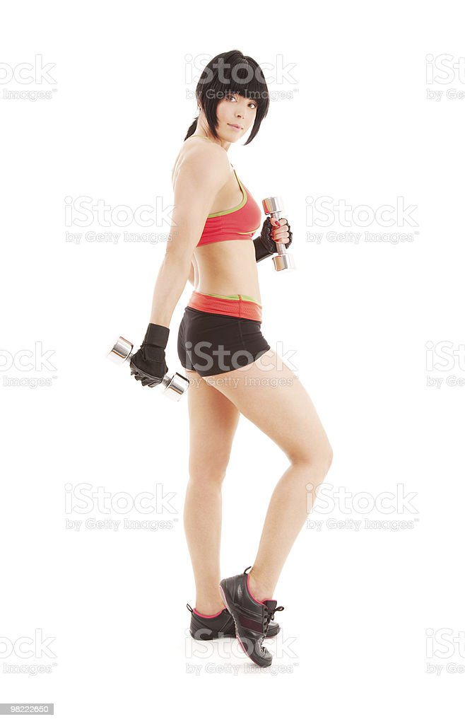 muscular fitness instructor with dumbbells royalty-free stock photo