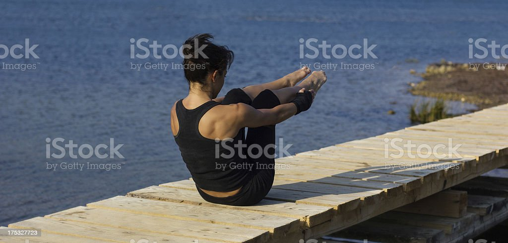 Muscular girl working out on the pier royalty-free stock photo