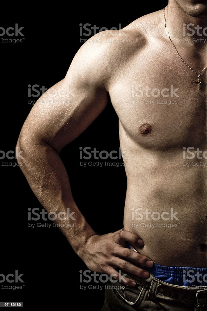 Muscular guy on black background royalty-free stock photo