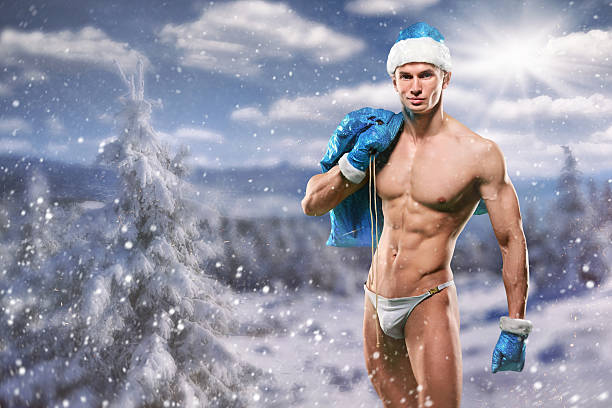 muscular handsome sexy santa claus - naked santa claus stock pictures, royalty-free photos & images