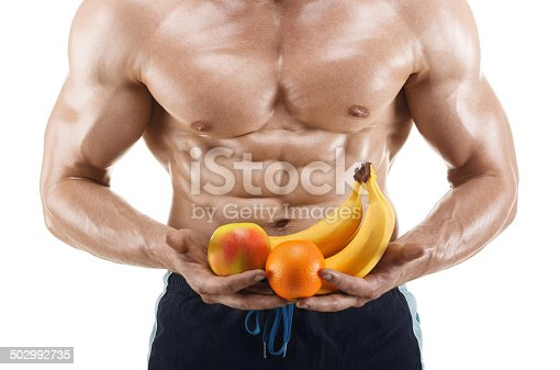 istock Muscular healthy man holding a fresh fruits, shaped abdominal 502992735