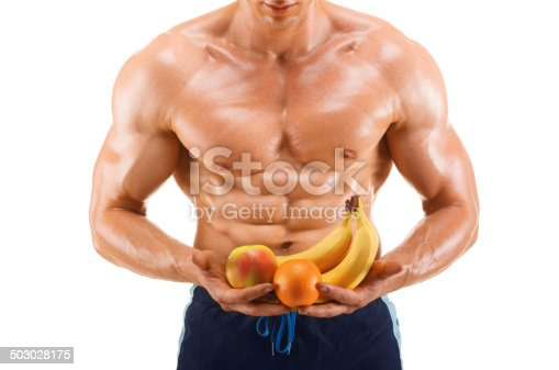 istock Muscular healthy man holding a fresh fruits, shaped abdominal 503028175
