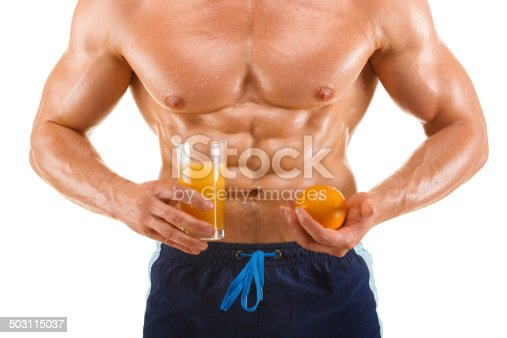 istock Muscular healthy man holding a juice and orange, shaped abdominal 503115037