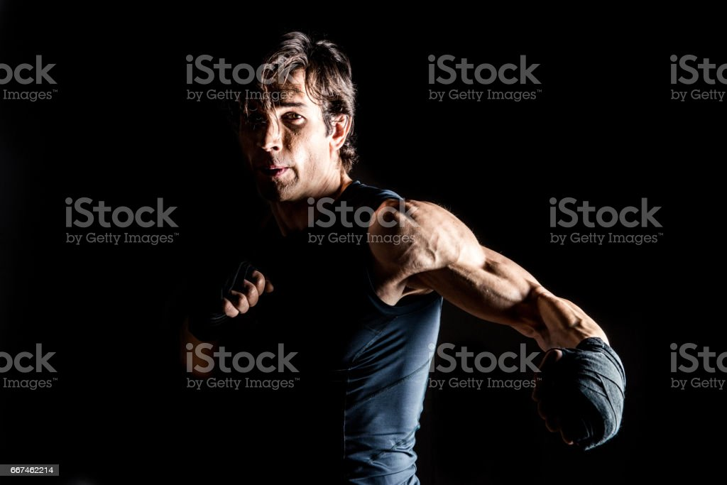 Muscular kickbox fighter stock photo