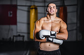 istock Muscular kickboxer showing muscles 1282735618