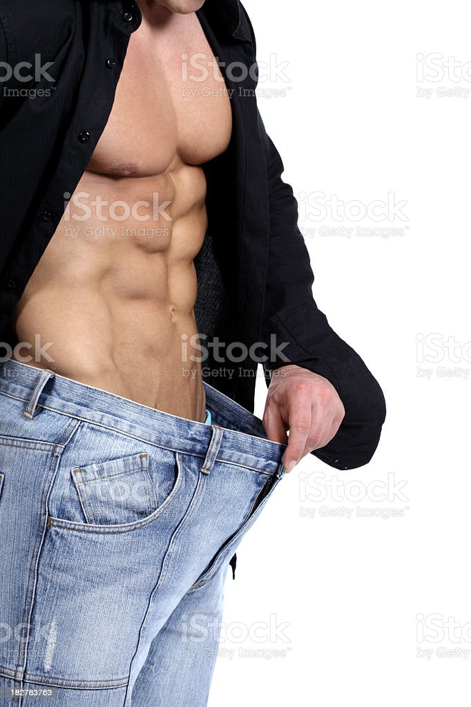 Muscular male body in oversized pants royalty-free stock photo