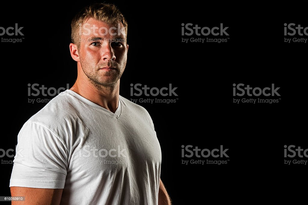 Muscular Male Portrait Against Black Background stock photo